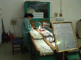 Tens of thousands of cocoons are sorted for size, color and quality before the silk threads are 'unspun'. There are up to 1650 meters of silk thread in each cocoon., Robert T - March 2008