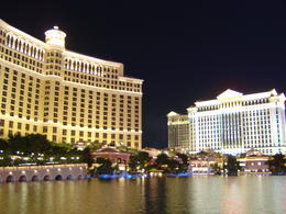 "The peaceful Bellagio Lake, in front of the hotel and Caesar's Palace, before the fountain begins another round of ""dancing."" , Leah - May 2011"