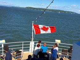 I took the St. Lawrence River Excursion option in Quebec City. This photo captures the flag flying majestically on our ship! It was a perfect day for a cruise, and I still had enough time to shop..., Kristine P - September 2016