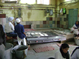 A feature of all Sikh temples is a community kitchen where anyone - any caste, any faith can come in for a meal. The kitchen is all staffed by volunteers , Balti-most - May 2011