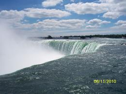 Canadian side, horseshoe falls up close and personal. you can walk to the edge. They say the falling water produces negative ions, a natural mood elevator. which is why you can not help but be..., Andrew G - June 2010