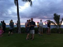 Jim and Tammie Fish enjoying the sun setting before the start of the luau. Mchale and Grayson Fish taking the picture. , James F - April 2014