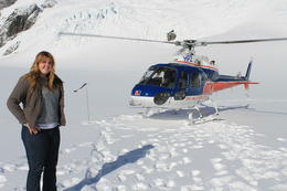 My daughter Caitlin standing on Fox Glacier in front of our helicopter. , MARY E - May 2013