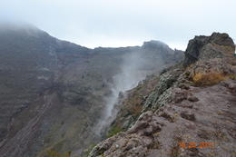 This volcano is still alive, notice the steam, you can smell the sulfur. , Richard P - October 2011