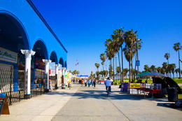 The boulevard on Venice Beach, sand and palm trees, Los Angeles. - May 2011