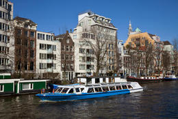 Tourist boat on canal in Amsterdam - May 2011