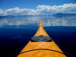 A kayak plies the crystal-clear waters of California's Lake Tahoe - April 2011