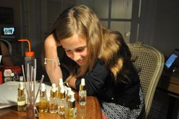 Caroline, age 10, choosing from the many scents to complete her perfume in the Perfume Workshop! , Charles A - August 2014