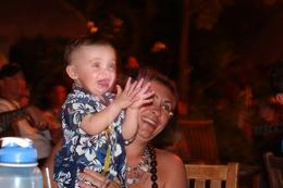 Braeden 1 year old and his mother Jerilyn enjoying the show at the Old Lahaina Luau in Maui. , shirley - April 2012