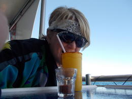 Peggy Nicolai, from Minnesota USA in Cabo on Los Cabos Sailing and Snorkel Cruise indulging in and quot;chili powder rimmed mango margarita and quot; enjoying every minute , Peggy N - February 2014