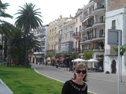 My wife stands in front of the line of restaurants that are the backdrop to the beach at Sitges. A really nice contrast with the beach. , David F - August 2011