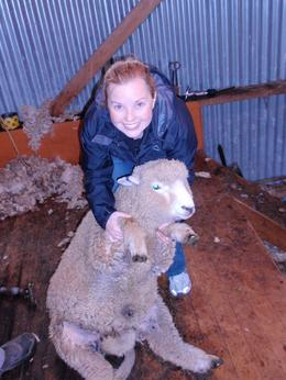 A picture of Maggie holding a sheep., Maggie - April 2009