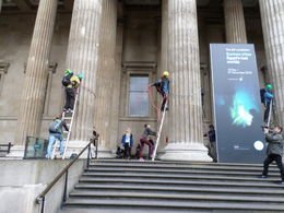 Protesters protesting corporate sponsorship of an upcoming exhibit by climbing columns in front of the British Museum. , Kevin W - May 2016