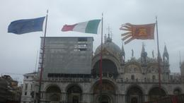 In front of St. Marco's Basilica...flags proudly waving., Vicki - December 2010