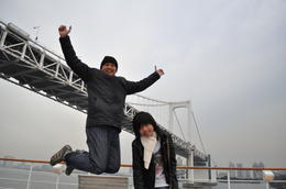 Me and my daughter,A big leap as we passed the Rainbow bridge in our Symphony cruise... , Eliseo H - January 2011