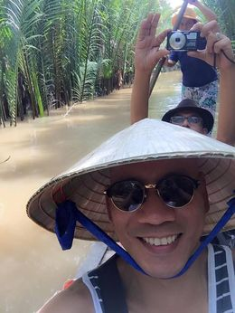 a selfie taken during a boat ride in Mekong river canal. , Crison M - October 2015