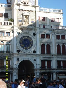 The time changes on the clock which is at each side of the statues. The guide explains how the clock is important to the local people., Gilbert B - September 2010