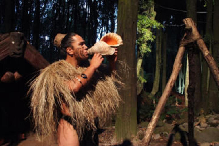 Rotorua_Tamaki Maori playing conch shell.jpg - Rotorua