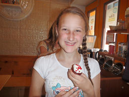 12 year old Milly with her creation. Redvelvet cupcake with vanilla buttercream and love heart sprinkles , Michelle O - May 2014