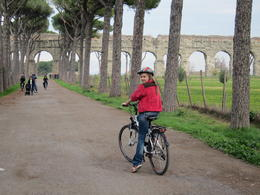 My grand daughter biking up the road that leads to the roman aqueducts. , MS shepherd - January 2012