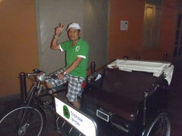 This was our lovely driver who transported us so expertly through the very busy traffic in Singapore during our 'Singapore's Chinatown Trishaw Night Tour' , john q - January 2016