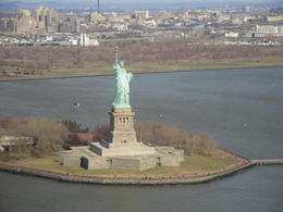 Flying over the statue of Liberty , Martin G - March 2011
