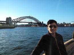 In this photo, Mr. Pralhad Giri, from Nepal is having a wonderful experience of Sydney cruise tour. Behind him, the wonderful harbour bridge is all about so tempting people to come here time and ... , Pralhad G - July 2014