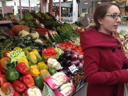 Tour guide at market. , Mary C O - November 2013