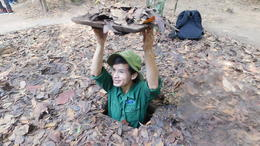 Man demonstrating opening to tunnel. , kahuchow - October 2017