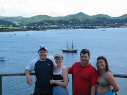 This is the picture that my husband, my sister, brother in law and I had taken overlooking Rodney Bay. The ship in the background was featured in Pirates of the Caribbean., Michael J - December 2007