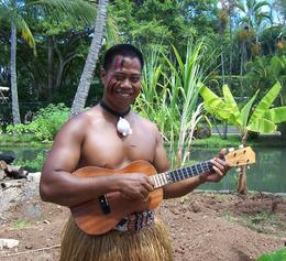 One of the villagers plays a Ukelele, Polynesian Cultural Center, Margaret G - September 2009