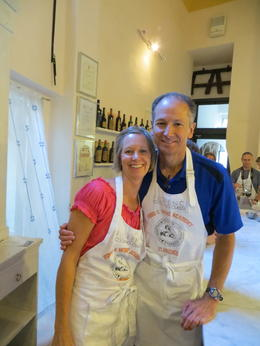 Roddy and Connie in our aprons, ready to make wonderful Italian pizza at Giovanni's Italian Cooking Class by Food and Wine Academy of Florence. , Connie C - June 2012
