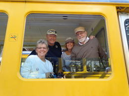 My best friends in Switzerland and the US. Reba, Robert, my wife Kathy and Gary. Our perfect guide(KID) offered to take our pictures. He did this with everyone on our private car! , Gary F - September 2014