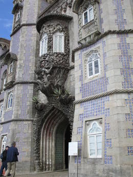 The entrance was guarded by a triton above the door. , RICHARD S - June 2013