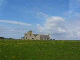 Beautiful day on Orkney with a typical stone house in a green field and blue sky. , William B - July 2013