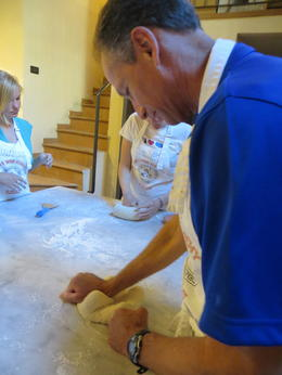 Roddy is doing a great job at kneading the dough. We took turns doing this for 15 minutes.....that makes a great pizza crust they tell us. , Connie C - June 2012