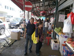 My dad walks past as I look that the watermelons and dragon fruit for sale. , Charity - November 2017