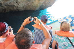 A boat with about 6-8 tourists brings you to the Blue Grotto , JumpingNorman - September 2014