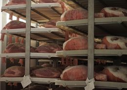 Hams on a rack for processing. , SAMUEL A - September 2015