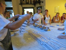Giovanni covering up all our pizza dough balls so they can rise for 15 minutes. , Connie C - June 2012