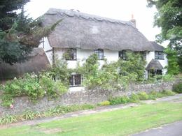 Charming thatched roof cottage in the Cotswolds where we were able to stop for a photo op for just a few seconds, Valerie F - September 2009