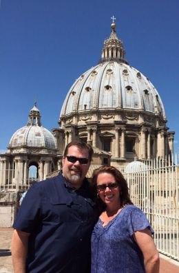John and Kathy W. on the roof of the Basilica with the dome of St. Peters in the background , Katherine W - May 2015