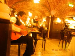 The musicians in the restaurant that sounded like an animal caught in a trap. , James C - June 2013