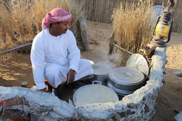 Local Emirati cooking a traditional breakfast in the village. , Edward W - December 2014