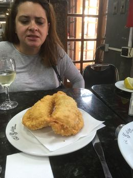 Here Kathy and us are finishing off a fantastic but tiring day with empanadas and wine , Susan J - April 2016