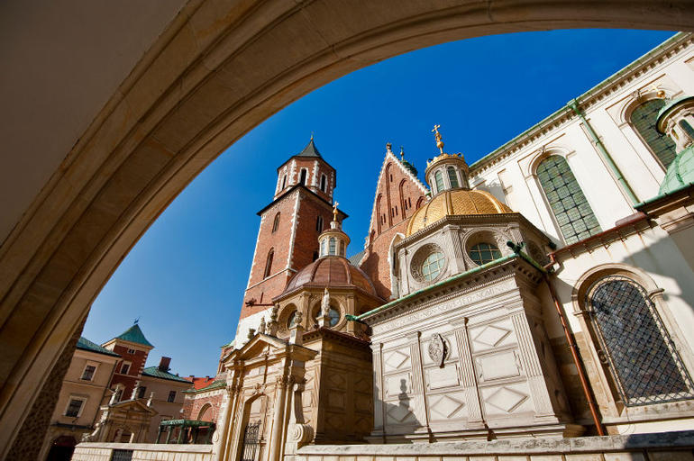 Wawel Cathedral in Krakow viewed from behind a gothic arch - Krakow