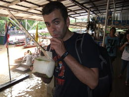 Couldn't miss out the floating market coconut experience! , Fernando Camarate Santos - October 2012