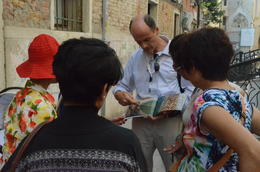 Stefano, well prepared with his books, explaining to us the mechanics of the buildings , Rosy Yung - July 2014