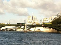 Notre Dame and one of the many beautiful bridges seen on the river cruise , Elizabeth W - October 2012