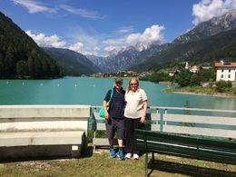 Gai and Bernie on the edge of Lake Katherine in the Dolomite region, and yes the lake is really that colour. Beautiful! , Gai K - August 2016
